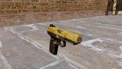 Arma FN Cinco sete de Ouro